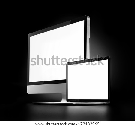 two computers with white screen on a dark background - stock photo