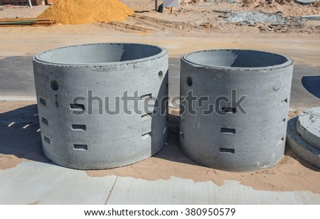 Two concrete soakwells on the construction site before installation - stock photo