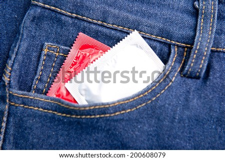 two condom in jeans pocket, safe sex - stock photo