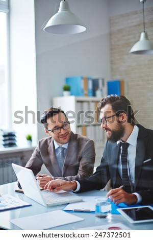 Two confident businessmen brainstorming while planning work - stock photo