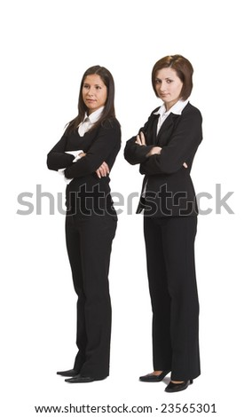 Two confident businesswomen standing up against a white background. - stock photo
