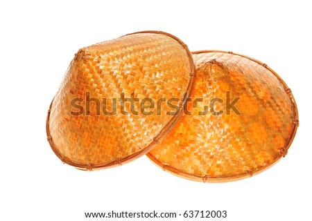 Two Conical Straw Hats on white background