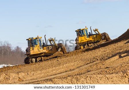 Two Construction bulldozer at Work in forest - stock photo