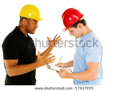 two construction men discuss project - stock photo