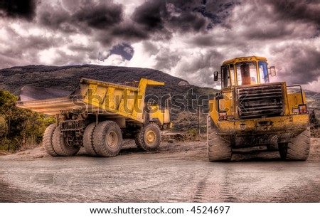 Two construction vehicles - stock photo