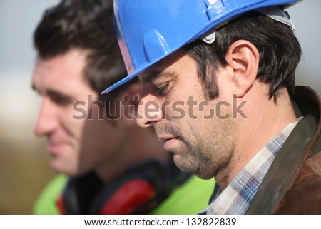 Two construction worker at the site - stock photo