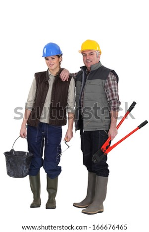Two construction workers - stock photo