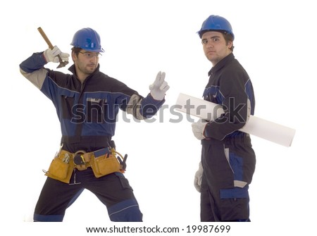 Two construction workers conflict about project - stock photo