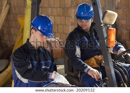 Two construction workers looking plan - stock photo