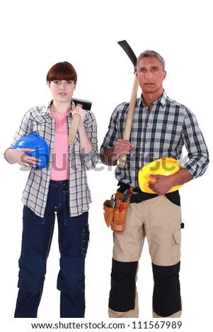 two construction workers posing together - stock photo