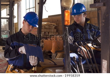 Two construction workers work plan - stock photo