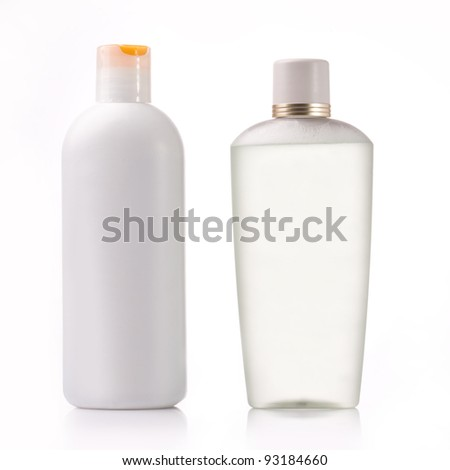 Two containers of cosmetic isolated on white. - stock photo