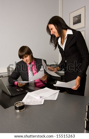 Two contemporary business people at a meeting