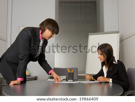 Two contemporary businesspeople at a meeting