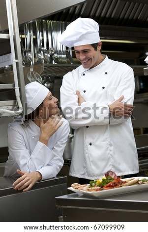 Two Cooks speaking in the kitchen - stock photo