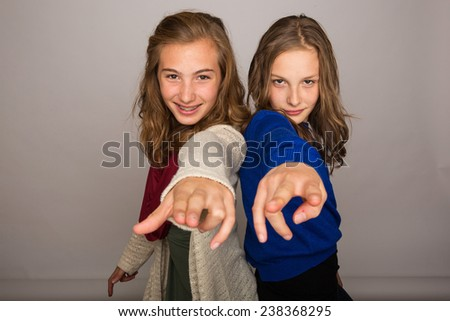 two cool kids pointing - stock photo