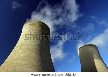 Two Cooling Towers at a coal-fired power station - stock photo