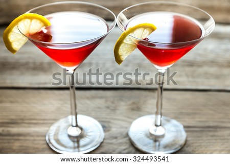 Two cosmopolitan cocktails on the wooden background - stock photo