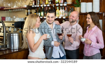Two couple of lovers hanging out in a bar drinking alcohol and coffee - stock photo