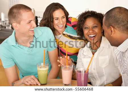 Two couples at a cafe drinking frozen beverages. Horizontal shot. - stock photo