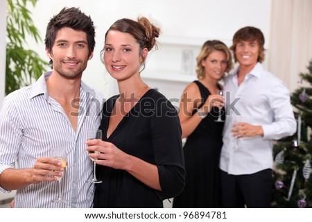 Two couples celebrating Christmas - stock photo
