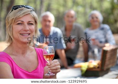 Two couples enjoying picnic - stock photo