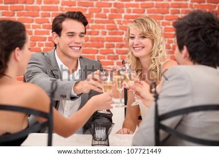 Two couples providing - stock photo