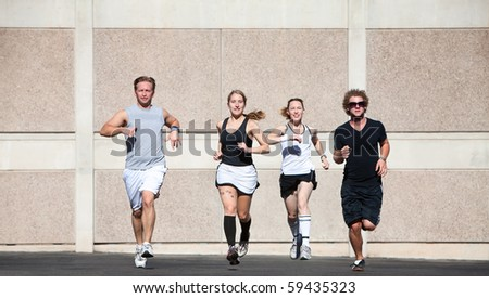 Two couples running for fun.