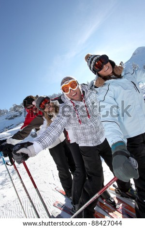 Two couples skiing together - stock photo