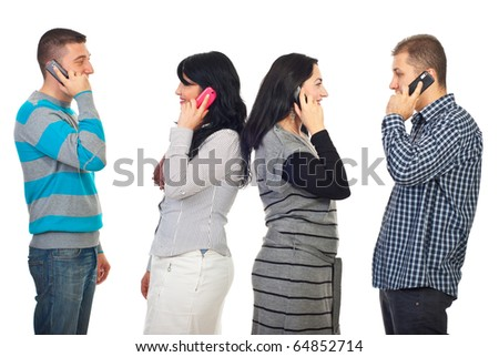 Two couples talking by phone mobiles and each of them standing in profile  isolated on white background - stock photo