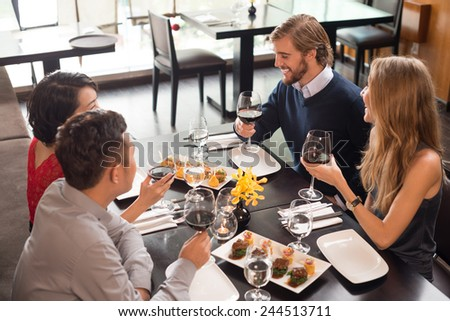 Two couples toasting at the celebration in the restaurant - stock photo