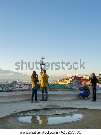 Two couples visit Park Guell in Barcelona, Spain in the morning  - stock photo