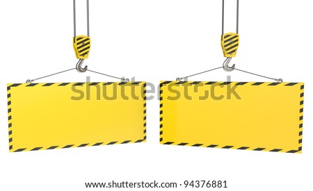 Two crane hooks with blank yellow plates, isolated on white background - stock photo