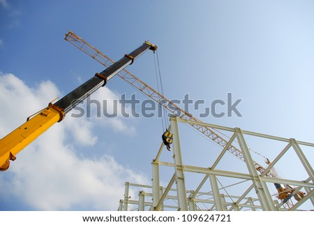 Two cranes at a construction site - stock photo