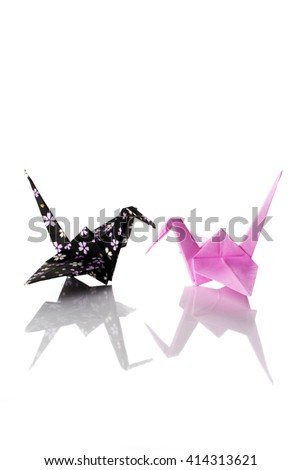 Two cranes origami made of decorated paper isolated on white background. - stock photo