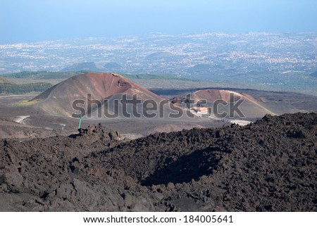 Two craters on the base of mt. Etna with sea and towns beneath, Lipari, Sicily, Italy - stock photo