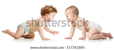 two crawling babies boy and girl - stock photo