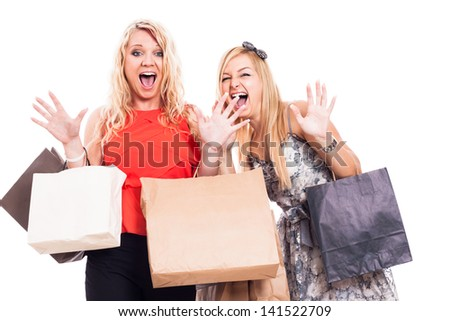 Two crazy blond girls shopping, isolated on white background - stock photo