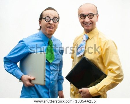 Two crazy businessman with laptops - stock photo