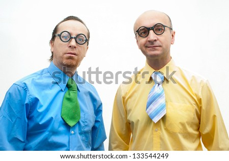 Two crazy businessmen on the white background - stock photo