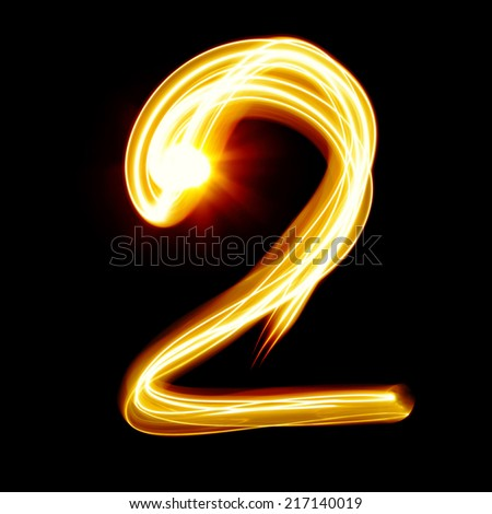 Two - Created by light numerals over black background - stock photo