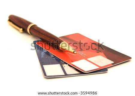Two credit cards and pen, isolated over white background - stock photo