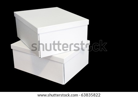 Two crisp white cardboard boxes isolated on black background with copy space - stock photo