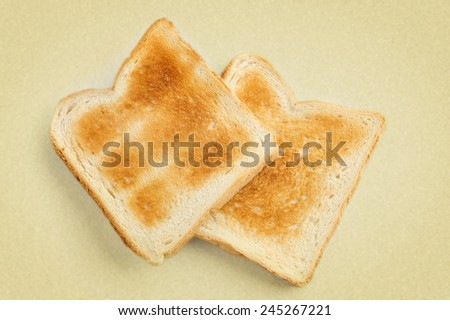 two crispy toast on a white background. picture in retro style.