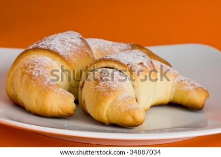 Two croissant with marmolade and sprinkled with sugar