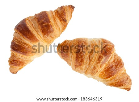 Two croissants isolated on white with clipping path - stock photo