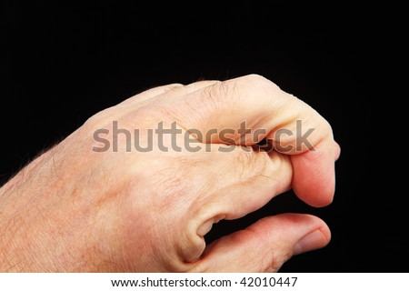 Two crossed fingers on the left hand - stock photo