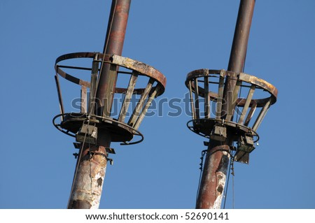 Two crow nests on an old sailing ship - stock photo