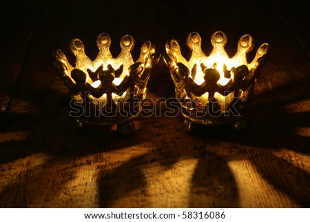 Two Crown candles still life portrait - stock photo