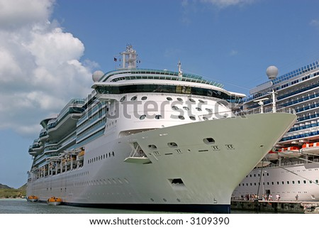 Two Cruise ships docked alongside each other in port - stock photo